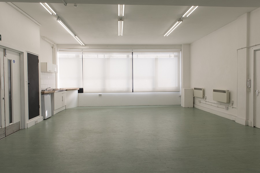 White room with green flooring